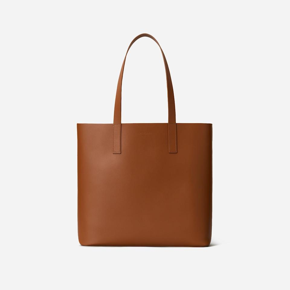 """<p><strong>Everlane</strong></p><p>everlane.com</p><p><strong>$168.00</strong></p><p><a href=""""https://go.redirectingat.com?id=74968X1596630&url=https%3A%2F%2Fwww.everlane.com%2Fproducts%2Fthe-day-square-tote-cognac&sref=https%3A%2F%2Fwww.harpersbazaar.com%2Ffashion%2Ftrends%2Fg5645%2Fmothers-day-gift-guide%2F"""" rel=""""nofollow noopener"""" target=""""_blank"""" data-ylk=""""slk:Shop Now"""" class=""""link rapid-noclick-resp"""">Shop Now</a></p><p>If your mom isn't yet familiar with sustainable brand Everlane, now's the time to introduce her. This leather caryall (which also fits a laptop) is the perfect day bag for every woman. </p>"""