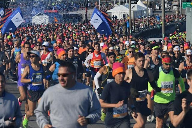 Long-distance runners such as these in the 2019 New York City Marathon will not be able to compete in New York or Berlin this year after both cities announced Wednesday their marathons were canceled for 2020 due to coronavirus pandemic issues (AFP Photo/Angela Weiss)