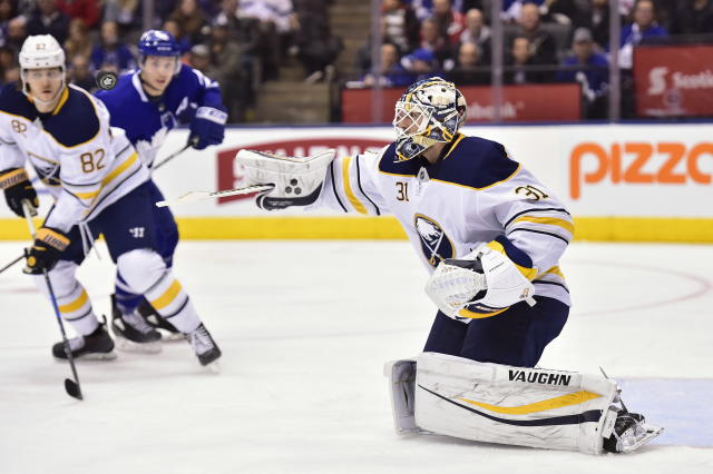 Buffalo Sabres goaltender Chad Johnson (31) swats at a puck in the air during second period NHL hockey action against the Toronto Maple Leafs in Toronto on Monday, March 26, 2018. (Frank Gunn/The Canadian Press via AP)