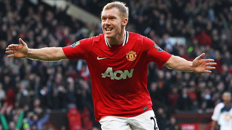 Paul Scholes, pictured here celebrating a goal for Manchester United in 2012.