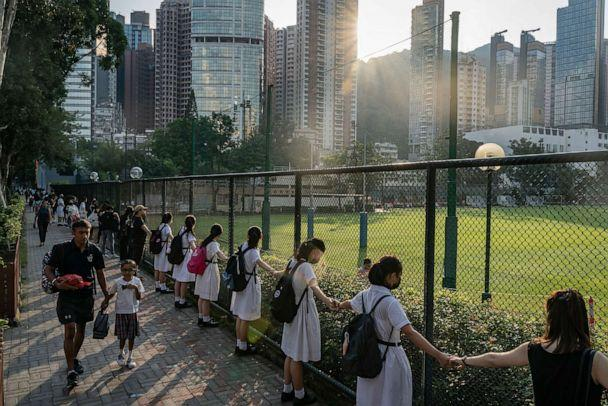 PHOTO: Students and alumni form a human chain outside a school, Sept. 9, 2019 in Hong Kong, in support of pro-democracy activists. (Anthony Kwan/Getty Images)