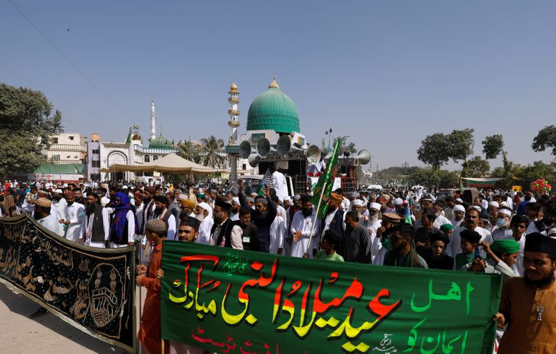 People protest against the cartoon publications of Prophet Mohammad in France during a rally to mark the birth anniversary of Prophet Mohammad, in Karachi