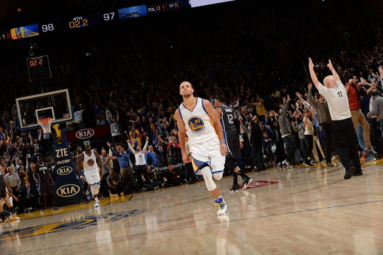 Curry's 3 lifts Warriors over Magic, 98-97