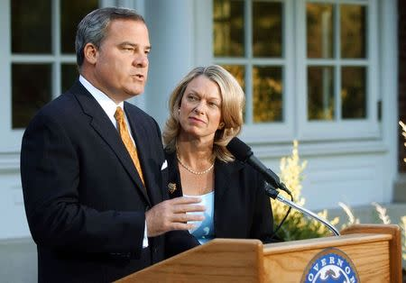 Three-term Republican Connecticut Governor John Rowland with his wife Patty at his side, makes a televised address from the governor's residence in Hartford