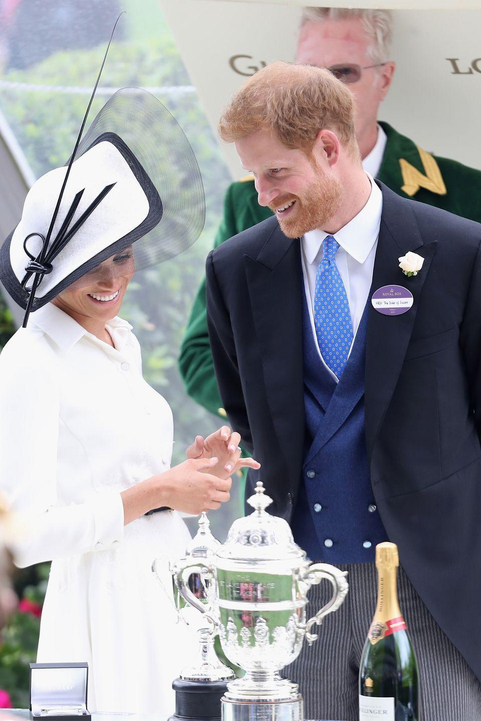 """<p>Exactly a month after their wedding, the newlyweds were all smiles at the <a href=""""https://www.harpersbazaar.com/celebrity/latest/a21613382/meghan-markle-prince-harry-royal-ascot-2018/"""" rel=""""nofollow noopener"""" target=""""_blank"""" data-ylk=""""slk:Royal Ascot"""" class=""""link rapid-noclick-resp"""">Royal Ascot</a>. </p>"""