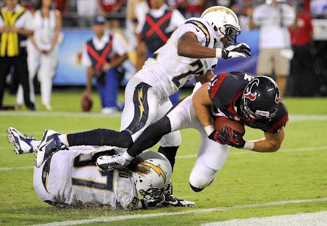 Houston Texans tight end Garrett Graham, right, scores between San Diego Chargers linebacker Bront Bird, left, and running back Ronnie Brown during the second half of an NFL football game Monday, Sept. 9, 2013, in San Diego. (AP Photo/Denis Poroy)