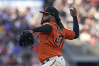 San Francisco Giants' Johnny Cueto pitches to a Pittsburgh Pirates batter during the first inning of a baseball game in San Francisco, Friday, July 23, 2021. (AP Photo/Jeff Chiu)