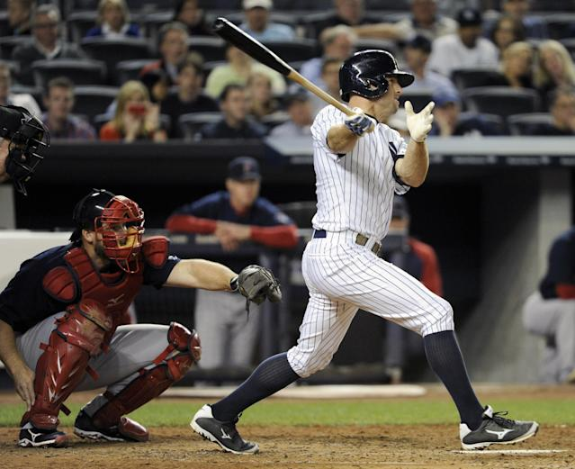 New York Yankees' Brett Gardner hits a two-RBI triple as Boston Red Sox catcher David Ross, left, looks on during the fourth inning of a baseball game, Friday, Sept. 6, 2013, at Yankee Stadium in New York. (AP Photo/Bill Kostroun)