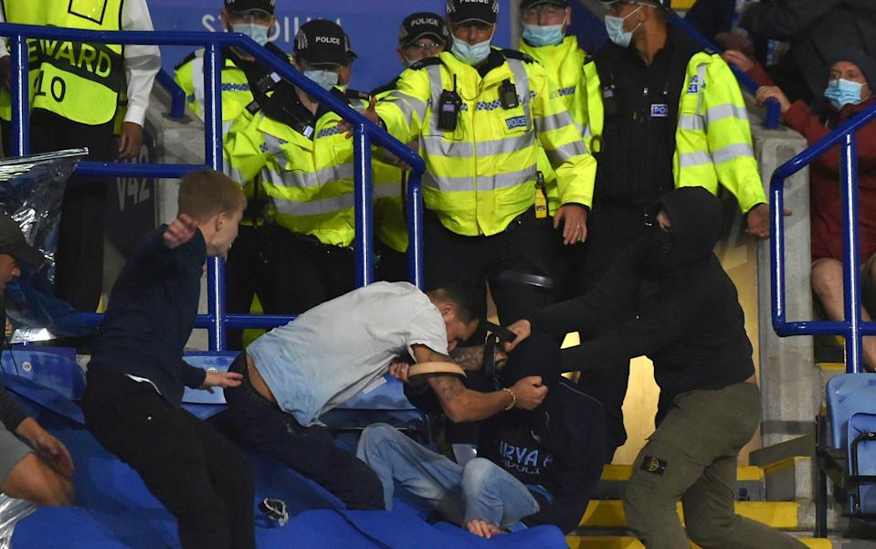 Napoli ultras fight with Leicester City fans and police as violence mars Europa League clash - AP