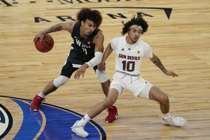 Washington State's Isaac Bonton drives around Arizona State's Jaelen House during the second half of an NCAA college basketball game in the first round of the Pac-12 men's tournament Wednesday, March 10, 2021, in Las Vegas. (AP Photo/John Locher)