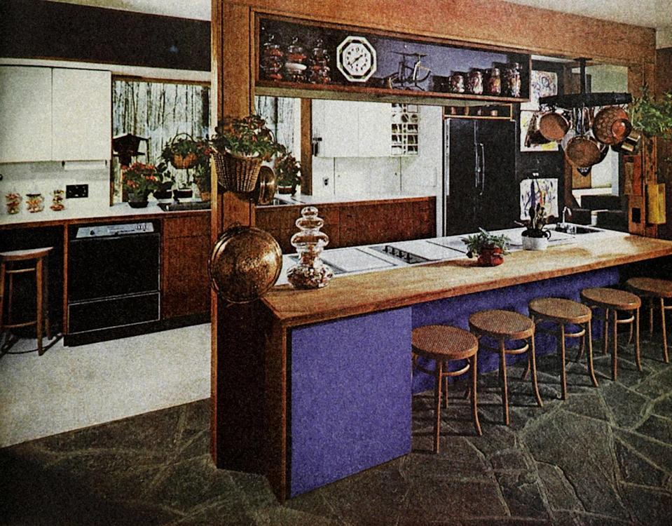 """The 1971 kitchen was full of appliances that were slowly improving, one feature at a time. Ice machines were popping up in refrigerators, microwaves were becoming portable for some reason, and the color avocado reigned supreme. Senior staff writer Alex Beggs breaks down how far we've come—and where we've fallen short. <a href=""""https://www.bonappetit.com/story/1971-kitchen-evolution?mbid=synd_yahoo_rss"""" rel=""""nofollow noopener"""" target=""""_blank"""" data-ylk=""""slk:See article."""" class=""""link rapid-noclick-resp"""">See article.</a>"""