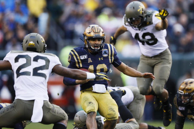 Navy quarterback Malcolm Perry runs the ball for a touchdown against Army during the first half of an NCAA college football game, Saturday, Dec. 14, 2019, in Philadelphia. (AP Photo/Matt Slocum)