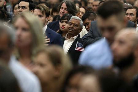 Immigrants attend a naturalization ceremony to become new U.S. citizens in Los Angeles, California, U.S., April 23, 2019. REUTERS/Lucy Nicholson