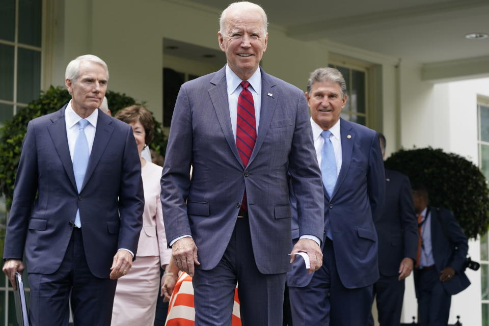 President Joe Biden, with from left, Sen. Rob Portman, R-Ohio, Sen. Susan Collins, R-Maine, and Sen. Joe Manchin, D-W.Va., and a bipartisan group of senators, walks out to speak to the media, Thursday June 24, 2021, outside the White House in Washington. Biden invited members of the group of 21 Republican and Democratic senators to discuss the infrastructure plan. (AP Photo/Jacquelyn Martin)