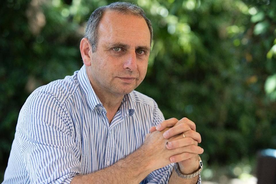 Israeli Moshe Farchi, the founder and head of the Stress, Trauma and Resilience Studies at Tel-Hai College, has developed an unorthodox model for treating mental trauma and preventing post-traumatic stress disorder. (AFP Photo/JACK GUEZ)