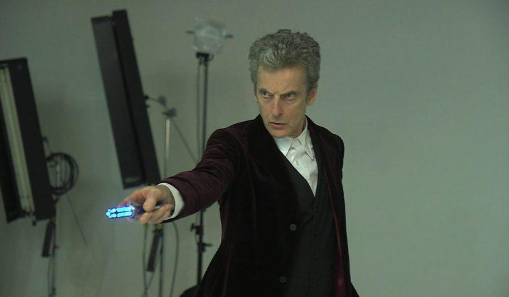 Peter Capaldi wields his sonic screwdriver - Credit: BBC