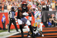 Cincinnati Bengals wide receiver Tee Higgins, front left, makes a catch for a two-point conversion in front of Green Bay Packers cornerback Isaac Yiadom (24) in the second half of an NFL football game in Cincinnati, Sunday, Oct. 10, 2021. (AP Photo/AJ Mast)
