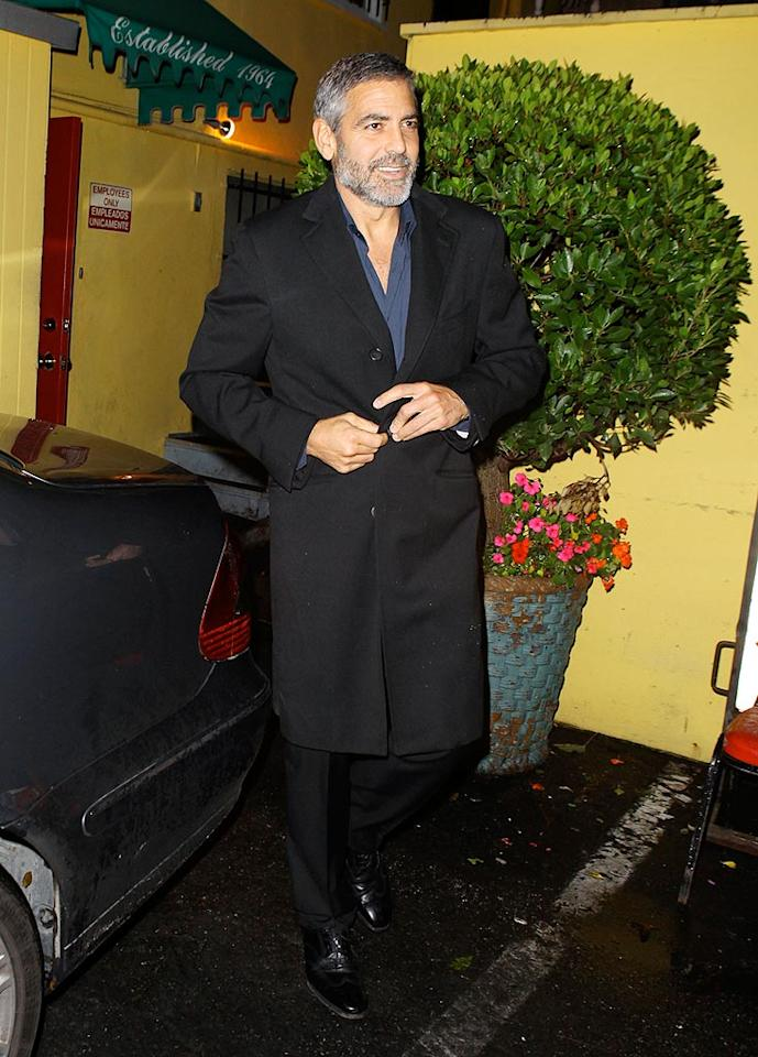 "George Clooney was Hollywood's golden boy this week, scoring a Best Actor Golden Globe nomination for his performance in ""Up in the Air."" The film received six nods, the most of any film at next year's Globes. Clooney, seen here leaving one of his favorite haunts, Dan Tana's in West Hollywood after a dinner with friends, typically downplayed the honor, commenting dryly, ""Not a bad way to start a Tuesday."" AKM IMAGES/<a href=""http://www.splashnewsonline.com"" target=""new"">Splash News</a> - December 12, 2009"