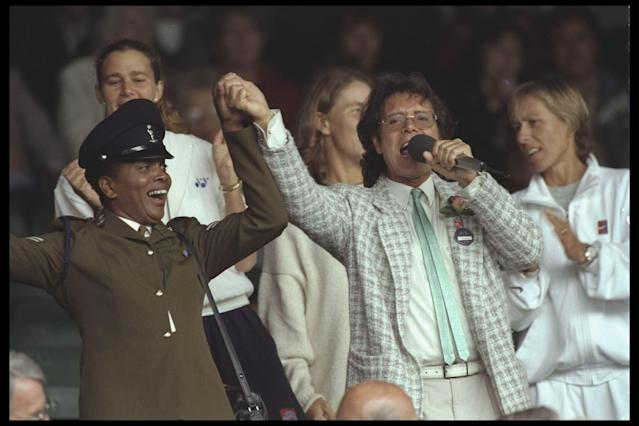 "<p class=""MsoNormal""><span>In <b>1996,</b> during a rainy afternoon on Centre Court, your Auntie's favourite British crooner Sir Cliff Richard (think Michael Bublé in 30 years), a frequent Wimbledon attendee, helped pass the time with an impromptu sing-along, including ""Singing in the Rain."" While the teenagers cringed, the adults managed to forget their sodden wool jumpers for half an hour or so.</span></p>"