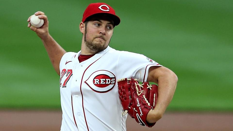 Trevor Bauer pitching for Reds in white jersey