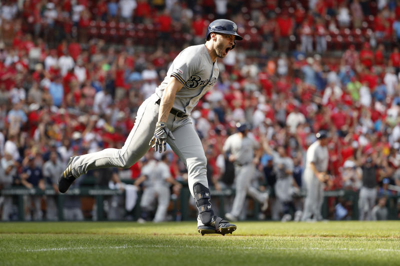 Milwaukee Brewers' Ryan Braun celebrates after hitting a grand slam during the ninth inning of a baseball game against the St. Louis Cardinals Sunday, Sept. 15, 2019, in St. Louis. (AP Photo/Jeff Roberson)
