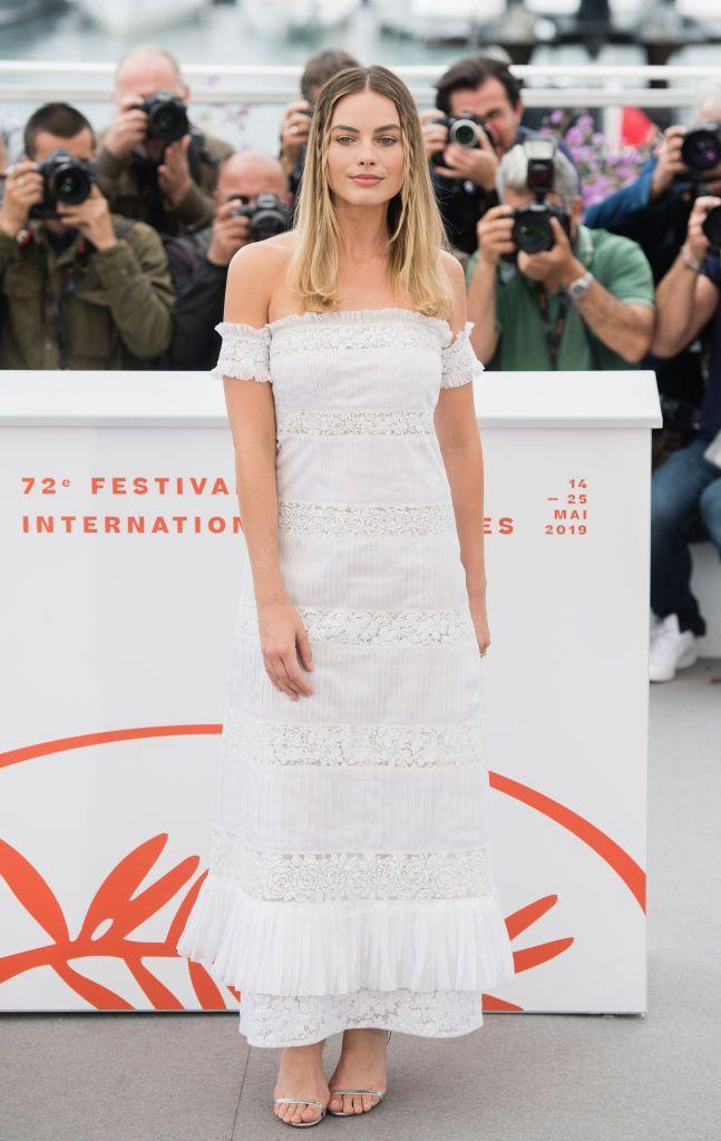 <p>Margot opted for a cute broderie Anglaise midi dress.</p>