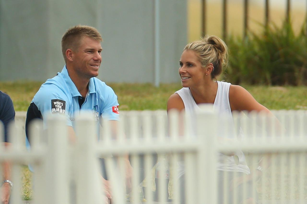 SYDNEY, AUSTRALIA - OCTOBER 22:  David Warner of the Blues and Candice Falzon watch on during the Ryobi Cup one day match between the South Australia Redbacks and the New South Wales Blues at Drummoyne Oval on October 22, 2013 in Sydney, Australia.  (Photo by Mark Kolbe/Getty Images)
