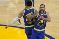 Golden State Warriors forward Juan Toscano-Anderson, left, celebrates with guard Mychal Mulder (15) during the second half of an NBA basketball game against the Utah Jazz in San Francisco, Monday, May 10, 2021. (AP Photo/Jeff Chiu)