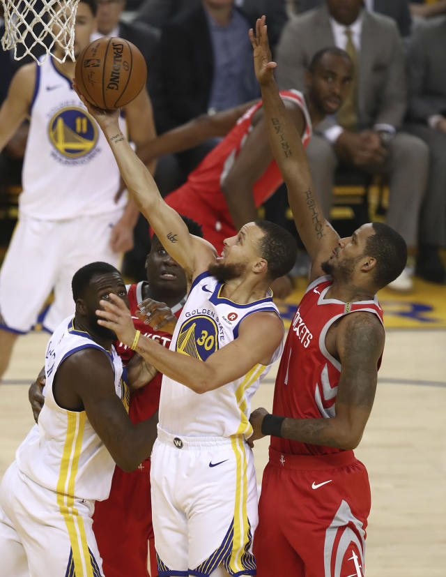 Golden State Warriors guard Stephen Curry (30) shoots in front of Houston Rockets forward Trevor Ariza, right, during the first half of Game 6 of the NBA basketball Western Conference Finals in Oakland, Calif., Saturday, May 26, 2018. (AP Photo/Ben Margot)