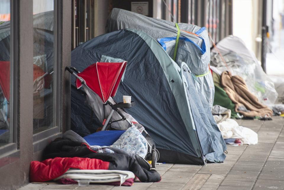 """<span class=""""caption"""">A small homeless camp is shown outside a department store in Montréal, Que., on Jan. 23, 2021, as the COVID-19 pandemic continues.</span> <span class=""""attribution""""><span class=""""source"""">THE CANADIAN PRESS/Graham Hughes</span></span>"""