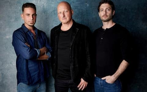 Wade Robson, from left, director Dan Reed and James Safechuck pose for a portrait to promote Leaving Neverland during the Sundance Film Festival - Credit: Taylor Jewell