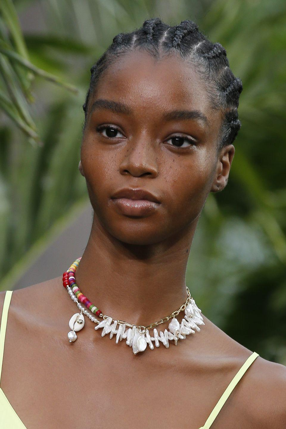 <p>Mix all your beaded jewels with pearls, shells, or medallion necklaces. </p><p><em>Jason Wu x Eliou</em></p>