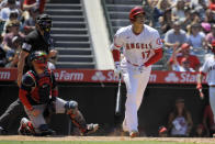 Los Angeles Angels' Shohei Ohtani, right, heads to first after hitting a solo home run as Boston Red Sox catcher Christian Vazquez, center, and home plate umpire Adam Beck watch during the fifth inning of a baseball game Wednesday, July 7, 2021, in Anaheim, Calif. (AP Photo/Mark J. Terrill)