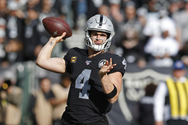 Oakland Raiders quarterback Derek Carr looks to throw the ball during the first half of an NFL football game against the Jacksonville Jaguars in Oakland, Calif., Sunday, Dec. 15, 2019. (AP Photo/D. Ross Cameron)
