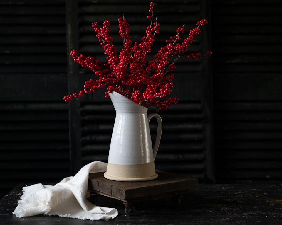<p>It may be as easy as it gets, but a bunch of berry branches makes for a quick and striking centerpiece that works just as well for the Christmas holiday as it does for fall.</p>
