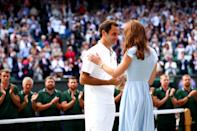 Kate presented friend Roger Federer with the runners-up trophy at Wimbledon 2019. Federer and his wife went to Kate's sister's wedding, and Prince George has had coaching from the former number one. (Clive Brunskill/Getty Images)