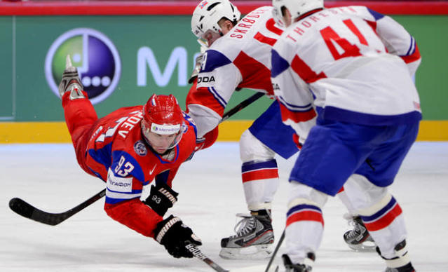 Norway's Patrick Thoresen (R) and Per-Age Skroder (C) fight for the puck with Russia's Nikolai Zherdev during a Quarter-finals match at the Ice Hockey World Championships in Stockholm on May 17, 2012. Russia won 5-2. AFP PHOTO/JONATHAN NACKSTRANDJONATHAN NACKSTRAND/AFP/GettyImages