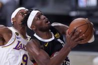 Denver Nuggets forward Jerami Grant (9) goes up for a shot in front of Los Angeles Lakers' Rajon Rondo, left, during the second half of Game 3 of the NBA basketball Western Conference final Tuesday, Sept. 22, 2020, in Lake Buena Vista, Fla. (AP Photo/Mark J. Terrill)