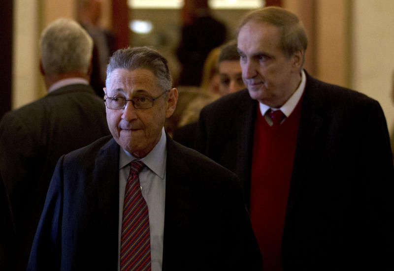 FILE- In this April 18, 2012, file photo, Assembly Speaker Sheldon Silver, D-Manhattan, left, walks with Assemblyman Vito Lopez, D-Brooklyn, to an affordable housing news conference at the Capitol in Albany, N.Y. Accusations of sexual harassment that emerged over the summer have unraveled in public before a state ethics committee, revealing more sexual misconduct accusations against Lopez and a secret six-figure payoff to the accusers with taxpayer money that was approved by Silver. (AP Photo/Mike Groll, File)