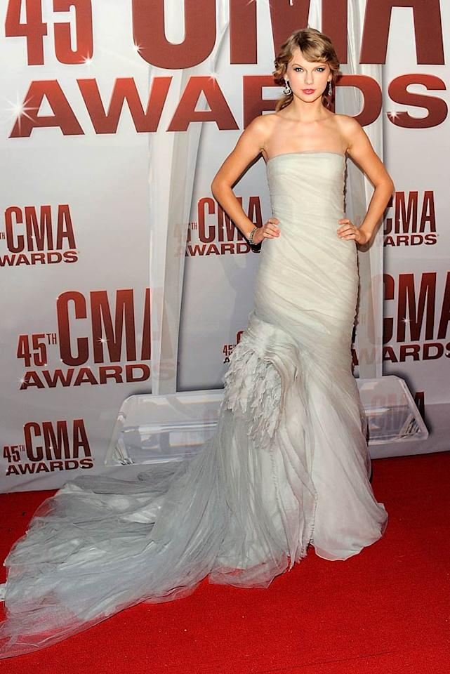 Taylor Swift looked ready to walk down the aisle at the 45th Annual CMA Awards thanks to her dramatic, bridal-like strapless gown featuring a tulle train. The 21-year-old Entertainer of the Year winner completed her ensemble with drop earrings and a swept-back 'do. (11/9/2011)