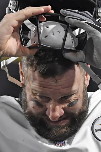 Pittsburgh Steelers quarterback Ben Roethlisberger takes off his helmet on the sideline during the second half of an NFL football game against the Buffalo Bills in Orchard Park, N.Y., Sunday, Dec. 13, 2020. (AP Photo/Adrian Kraus)