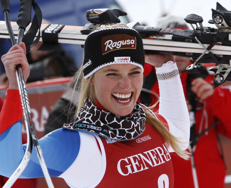 Switzerland's Lara Gut celebrates at the finish line after winning a women's Alpine Ski World Cup downhill race, in Val d'Isere, France, Friday, Dec.14, 2012. (AP Photo/Pier Marco Tacca)