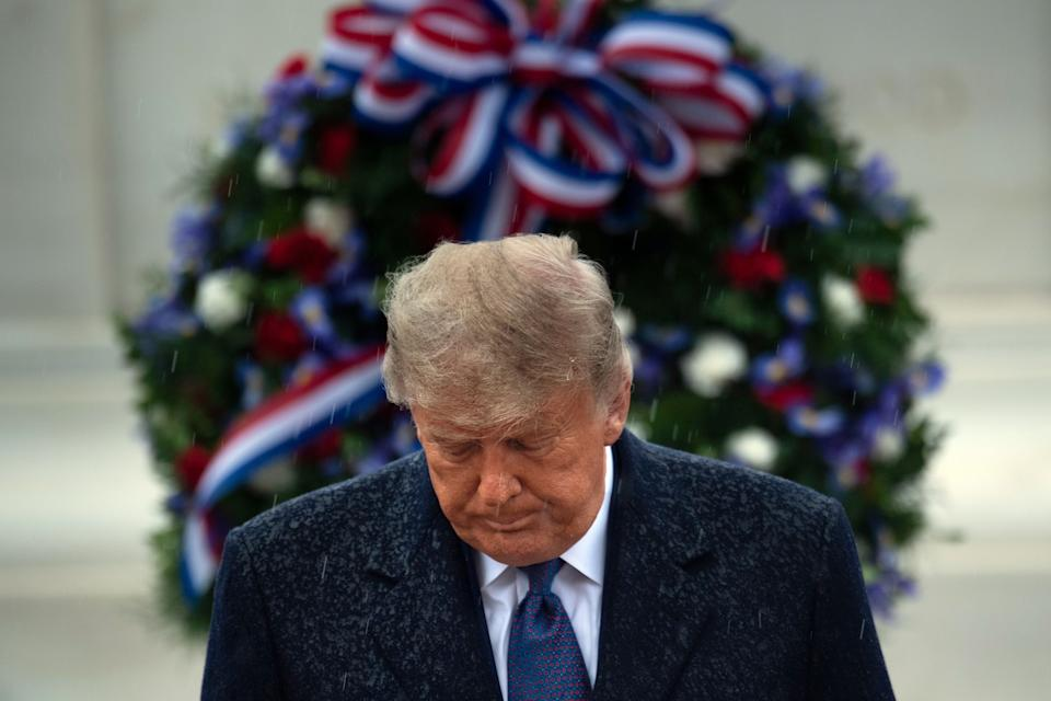 US President Donald Trump leaves after placing a wreath at the Tomb of the Unknown Soldier on Veterans Day at Arlington National Cemetery in Arlington, Virginia, on November 11, 2020. - US President Donald Trump made his first official post-election appearance Wednesday for what should be a moment of national unity to mark Veteran's Day, now marred by his refusal to acknowledge Joe Biden's win. The president visited Arlington National Cemetery, four days after US media projected his Democratic rival would take the White House. (Photo by Brendan Smialowski / AFP) (Photo by BRENDAN SMIALOWSKI/AFP via Getty Images)