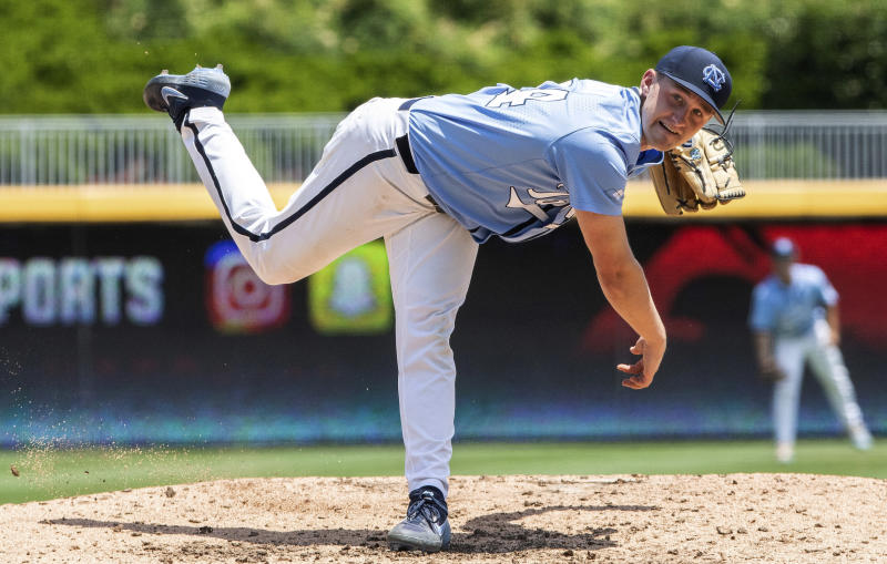 North Carolina's Hansen Butler (24) pitches during the ACC NCAA college baseball championship game against Georgia Tech, in Durham, N.C., Sunday, May 26, 2019. (AP Photo/Ben McKeown)
