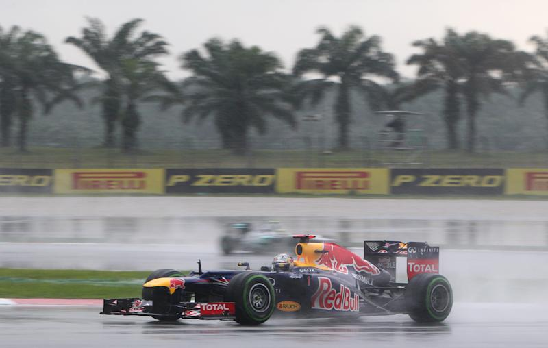 Red Bull Formula One driver Sebastian Vettel of Germany steers his car during the Malaysian Formula One Grand Prix at Sepang, Malaysia, Sunday, March 25, 2012. (AP Photo/Achmad Ibrahim)