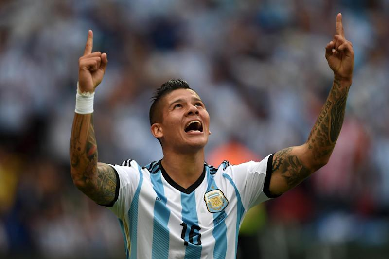 In this picture taken on June 25, 2014, Argentina's defender Marcos Rojo celebrates his goal during a Group F football match against Nigeria at the Beira-Rio Stadium in Porto Alegre during the 2014 FIFA World Cup