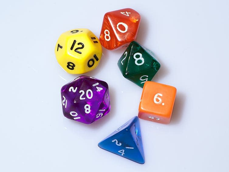 Dice with different numbers of sides of different colors.