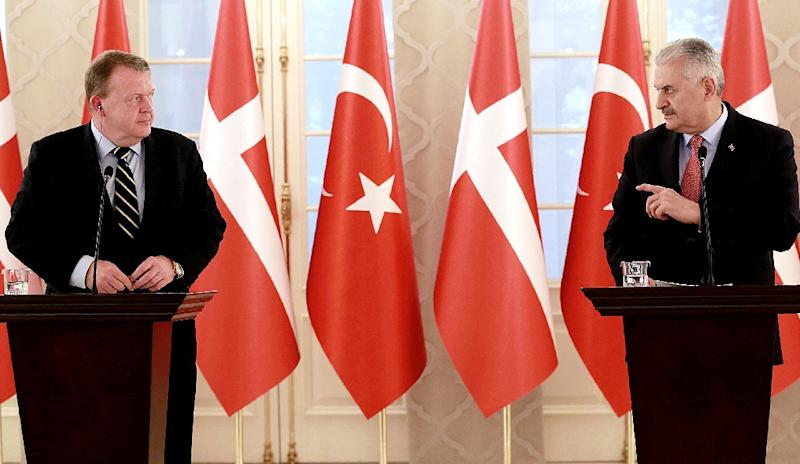 """On March 12, 2017, Danish Prime Minister Lars Lokke Rasmussen (L) called on his Turkish counterpart Binali Yildirim (R) to delay a visit planned for later this month because of """"tensions"""" between Ankara and the neighbouring Netherlands"""