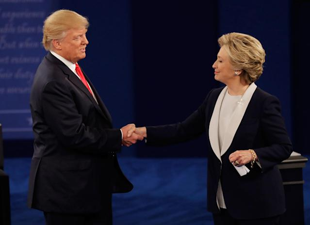 <p>Republican presidential nominee Donald Trump shakes hands with Democratic presidential nominee Hillary Clinton following the second presidential debate at Washington University in St. Louis, Sunday, Oct. 9, 2016. (Photo: Patrick Semansky/AP) </p>