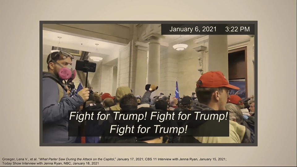 "This image from video shows one of many slides presented by Democrats prosecuting the impeachment of former President Donald Trump in the Senate at the U.S. Capitol in Washington, Wednesday, Feb. 10, 2021. The video, which showed Trump's supporters chanting ""Fight for Trump!"" after they stormed into the U.S. Capitol on Jan. 6, was used by prosecutors as they sought to connect the mob with Trump and make the case that the president had incited them to insurrection. (Senate Television via AP)"